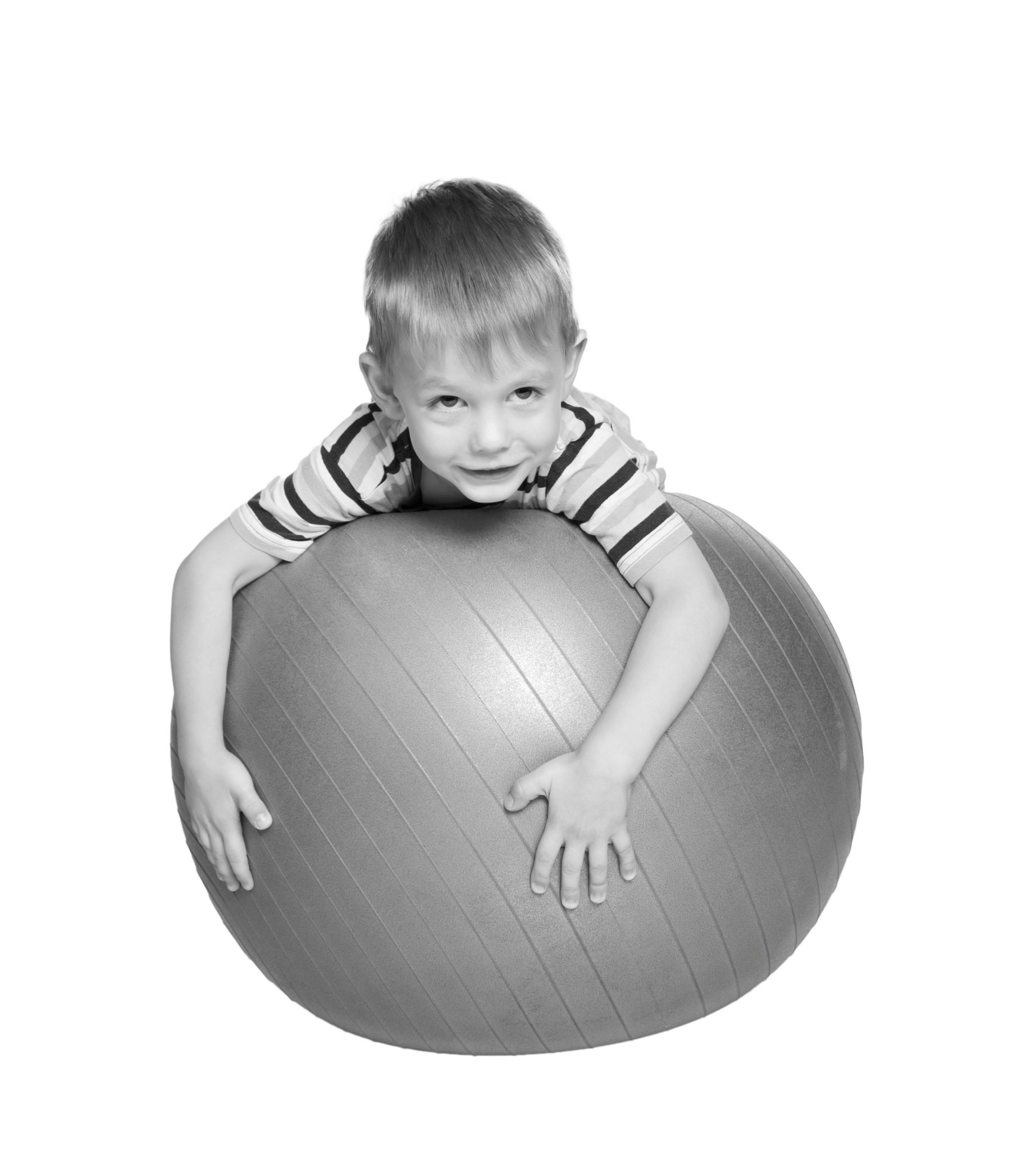 gutt med treningsball